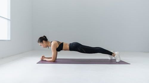 A girl doing a planking exercise