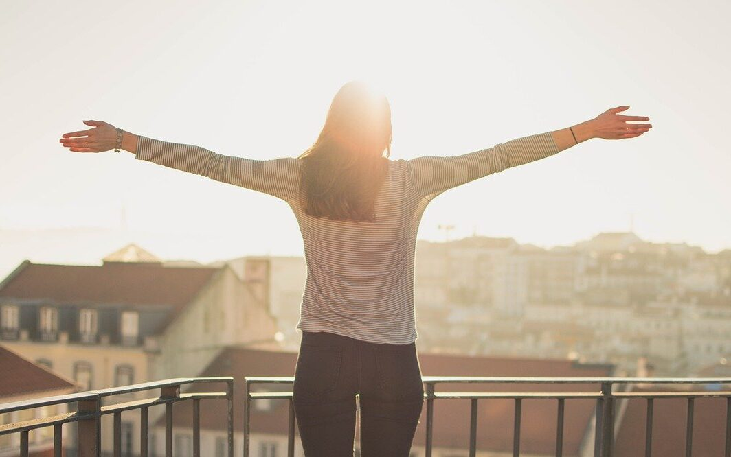 balcony, woman, standing, living intentionally, intentional living